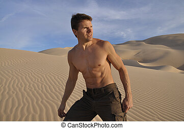 Desert hiker - Sexy muscular man hiking in desert sand dunes
