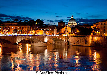 Night view to San Pietro basilica Vatican over Tiber river...