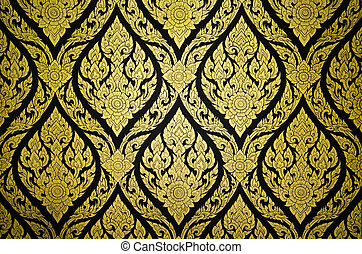 Thai floral pattern textured on a wall