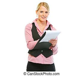 Woman employee writing in clipboard