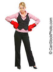 Full length portrait of business woman in boxing gloves