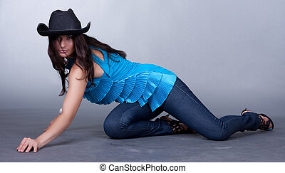 beautiful young woman in a hat