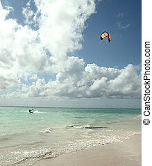 kite on the beach - man kiting near the beach