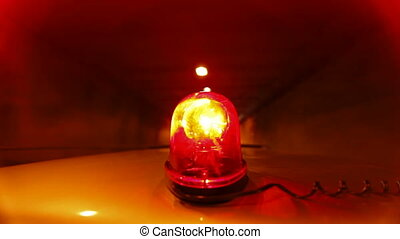 Car With Red Emergency Light Driving Through A Tunnel, Wide...