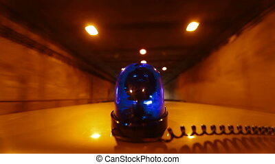 Car With Blue Emergency Light Driving Through A Tunnel, Wide...