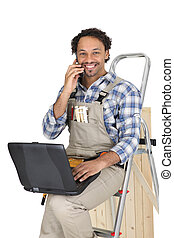 Tradesman typing on his laptop