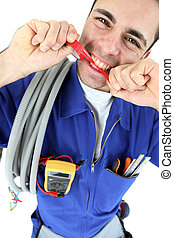 Electrician biting piece of plastic