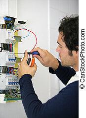 Man repairing faulty fuse box