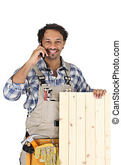 Woodworker standing with mobile phone