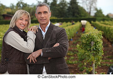 Couple in front of vineyard