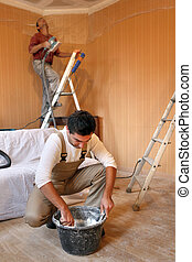 Workers in room under construction