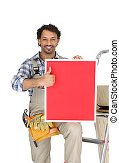 a handyman holding a panel
