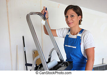 Woman redecorating her house