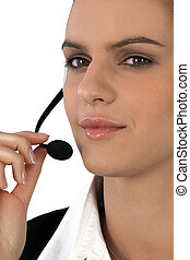 Close-up of a woman using a telephone headset