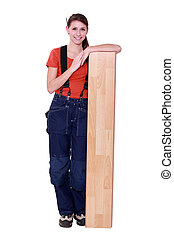 handywoman posing with a board