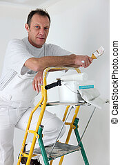 Painter posing by his ladder