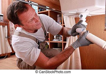 Plumbers repairing leak