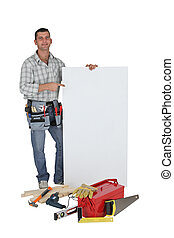 Carpenter stood with blank advertising panel