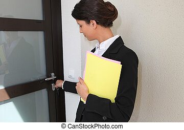 Estate agent opening a door