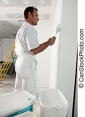 Decorator painting house