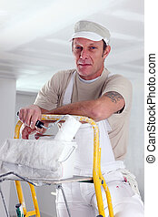Painter working on ceiling