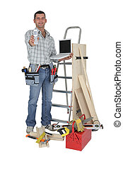 Carpenter with a phone and laptop