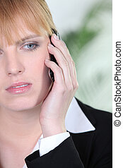 Woman worried on the phone
