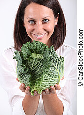 Woman showing cabbage