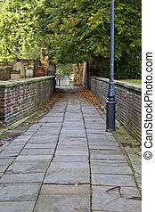 Old paved path next to Hexham Abbey grave yard