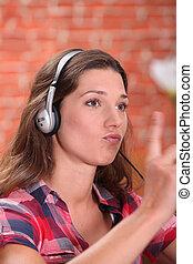 Woman with music rhythm