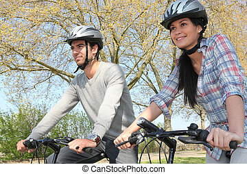 Couple cycling in autumn