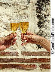 chin chin - closeup of hands making a toast with champaign...