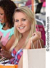 Two girls enjoying shopping trip