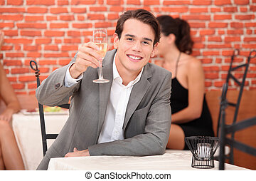 Man toasting with glass