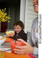 Family having breakfast on garden terrace