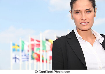 Executive Woman in front of flags