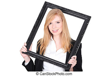 Young woman holding a picture frame around her head