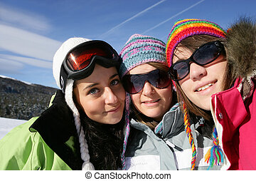 Three female friends on skiing holiday
