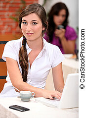 Couple in cafe with computer