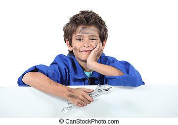 young mechanic boy