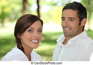 Man contemplating brown-haired woman