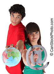 Young couple with a globe and sign
