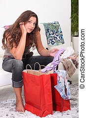 Woman looking at her purchases