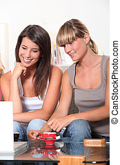 Young women browsing on the Internet