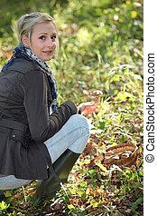 Woman picking mushrooms