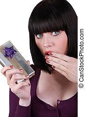 brunette stunned at gift