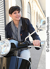 Woman on her motorcycle in the city