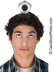 Teenager with a webcam on his head