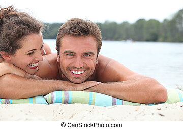 Couple relaxing by the lake