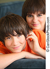 portrait of teenage boy and sister